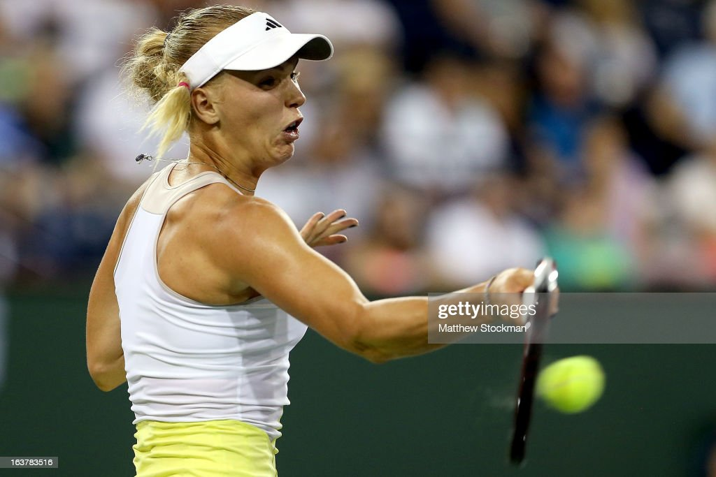 Caroline Wozniacki of Denmark returns a shot to Angelique Kerber during the BNP Paribas Open at the Indian Wells Tennis Garden on March 15, 2013 in Indian Wells, California.