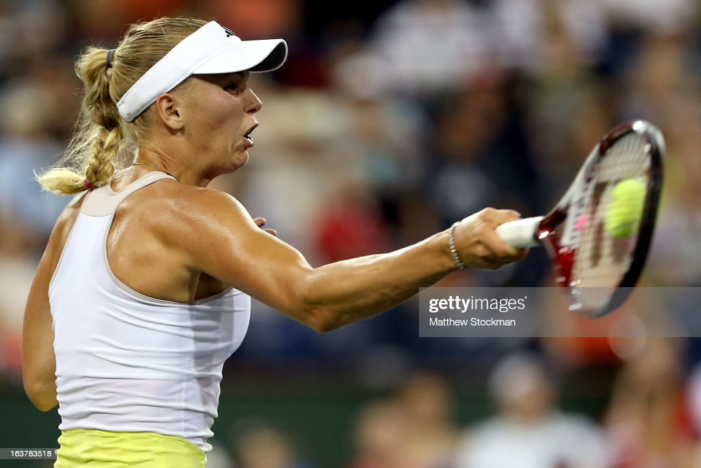 <a gi-track='captionPersonalityLinkClicked' href=/galleries/search?phrase=Caroline+Wozniacki&family=editorial&specificpeople=740679 ng-click='$event.stopPropagation()'>Caroline Wozniacki</a> of Denmark returns a shot to Angelique Kerber during the BNP Paribas Open at the Indian Wells Tennis Garden on March 15, 2013 in Indian Wells, California.