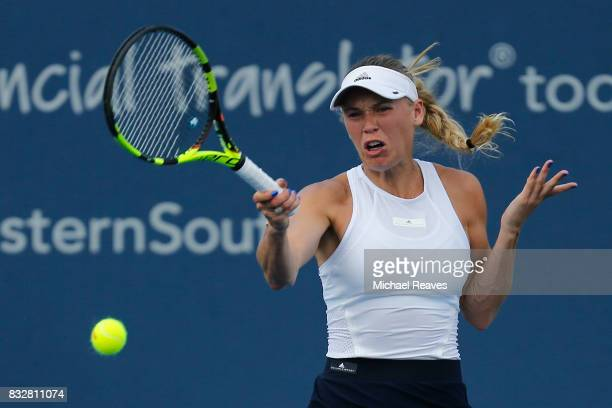 Caroline Wozniacki of Denmark returns a shot to Elena Vesnina of Russia during Day 5 of the Western and Southern Open at the Lindner Family Tennis...