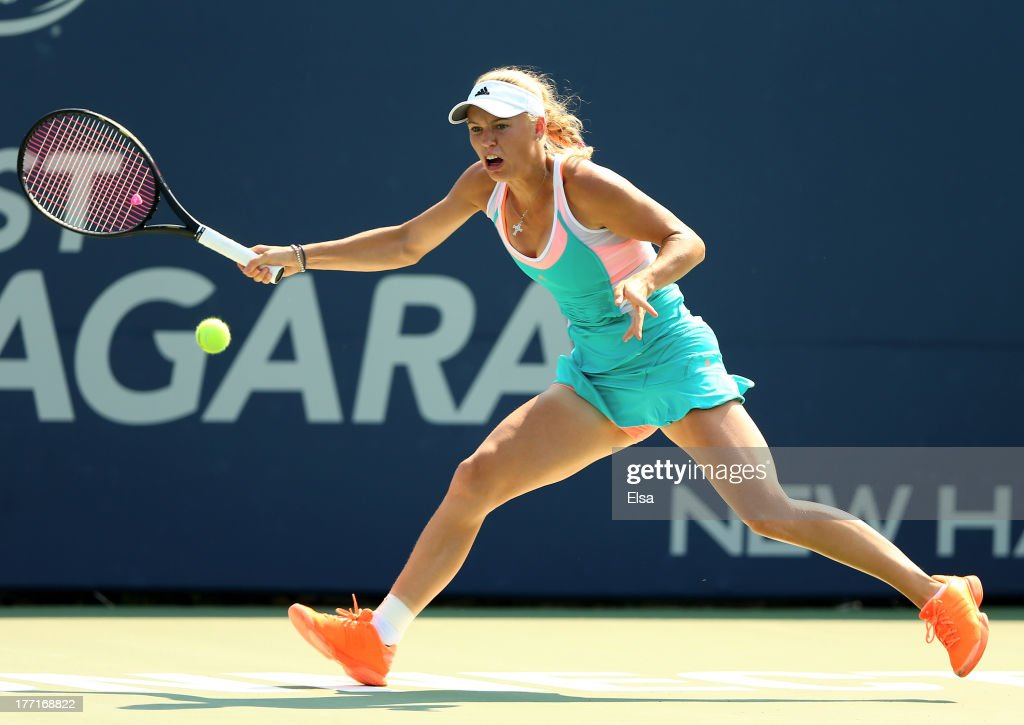 <a gi-track='captionPersonalityLinkClicked' href=/galleries/search?phrase=Caroline+Wozniacki&family=editorial&specificpeople=740679 ng-click='$event.stopPropagation()'>Caroline Wozniacki</a> of Denmark returns a shot to Karin Knapp of Italy during Day Four of the New Have Open at Connecticut Tennis Center at Yale on August 21, 2013 in New Haven, Connecticut.