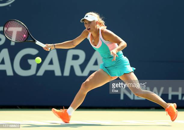 Caroline Wozniacki of Denmark returns a shot to Karin Knapp of Italy during Day Four of the New Have Open at Connecticut Tennis Center at Yale on...