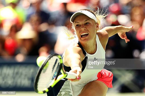 Caroline Wozniacki of Denmark returns a shot to Monica Niculescu of Romania during her third round Women's Singles match on Day Five of the 2016 US...
