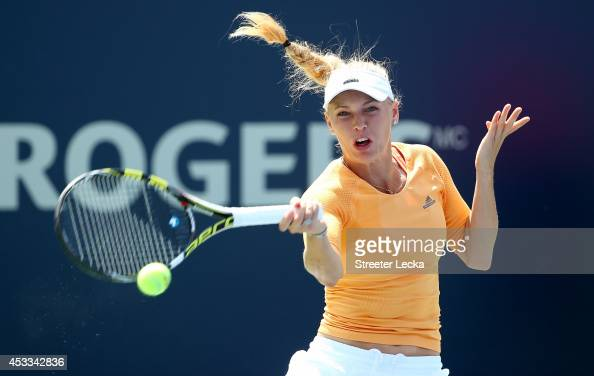 Caroline Wozniacki of Denmark returns a shot to Serena Williams of the USA in their quarterfinal match during the Rogers Cup at Uniprix Stadium on...