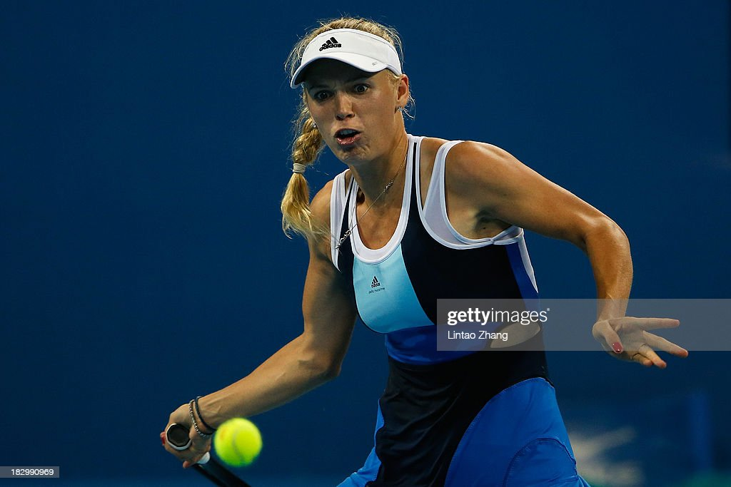 <a gi-track='captionPersonalityLinkClicked' href=/galleries/search?phrase=Caroline+Wozniacki&family=editorial&specificpeople=740679 ng-click='$event.stopPropagation()'>Caroline Wozniacki</a> of Denmark returns a shot to Sloane Stephens of the United States during day six of the 2013 China Open at the National Tennis Center on October 3, 2013 in Beijing, China.