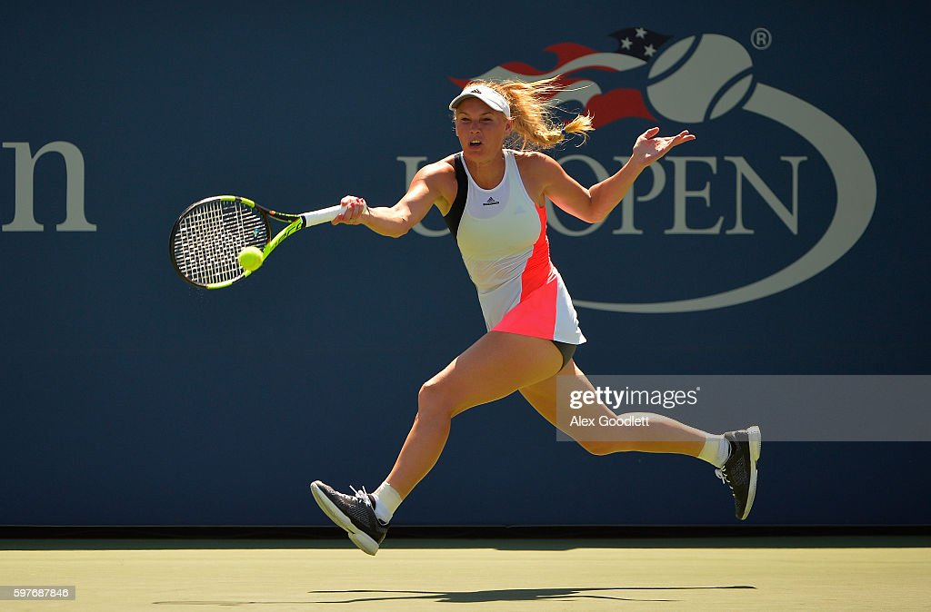 Caroline Wozniacki of Denmark returns a shot to Taylor Townsend of the United States during her first round Women's Singles match on Day One of the...