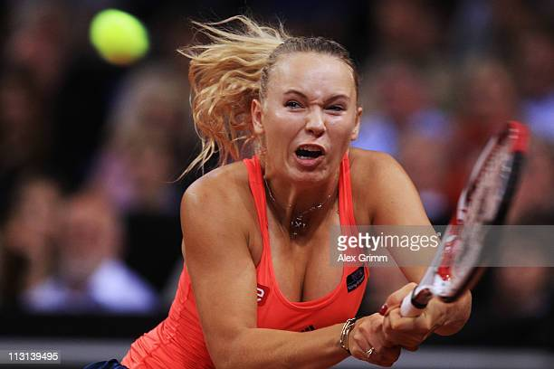 Caroline Wozniacki of Denmark returns the ball to Julia Goerges of Germany during the Final match at the Porsche Tennis Grand Prix at Porsche Arena...