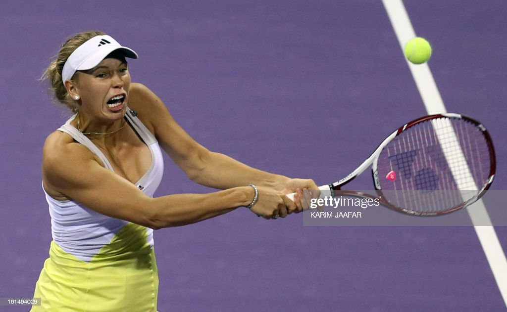 Caroline Wozniacki of Denmark returns the ball to Mervana Jugic Salkic of Bosnia during their match on the first day of the WTA Qatar Open in the capital Doha, on February 11, 2013.
