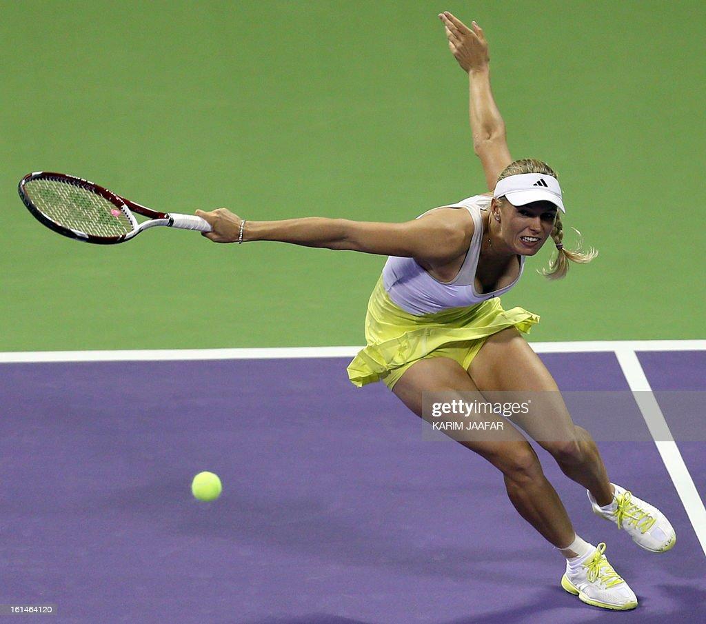 Caroline Wozniacki of Denmark returns the ball to Mervana Jugic Salkic of Bosnia during their match on the first day of the WTA Qatar Open in the capital Doha, on February 11, 2013.