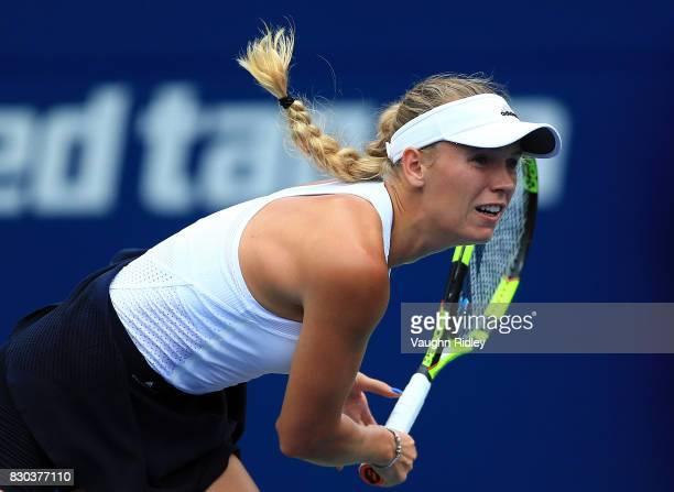 Caroline Wozniacki of Denmark serves against Karolina Pliskova of Czech Republic during Day 7 of the Rogers Cup at Aviva Centre on August 11 2017 in...
