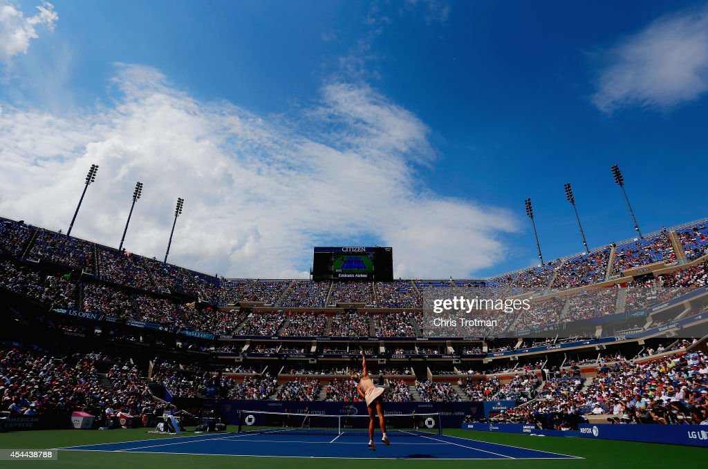 Caroline Wozniacki of Denmark serves against Maria Sharapova of Russia during their women's singles fourth round match on Day Seven of the 2014 US...