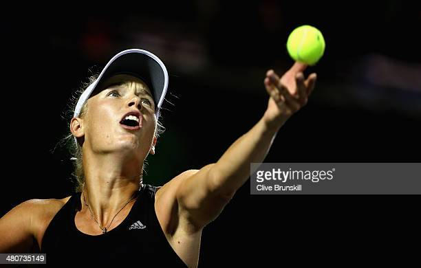 Caroline Wozniacki of Denmark serves against Na Li of China during their quarter final round match during day 10 at the Sony Open at Crandon Park...