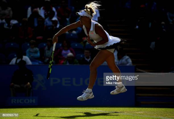 Caroline Wozniacki of Denmark serves during the ladies singles quarter final match against Simona Halep of Romania on day five of the Aegon...