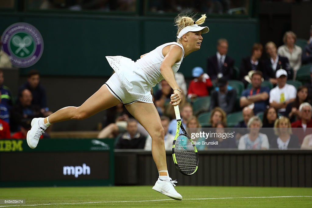 <a gi-track='captionPersonalityLinkClicked' href=/galleries/search?phrase=Caroline+Wozniacki&family=editorial&specificpeople=740679 ng-click='$event.stopPropagation()'>Caroline Wozniacki</a> of Denmark serves during the Ladies Singles first round match against Svetlana Kuznetsova of Russia on day two of the Wimbledon Lawn Tennis Championships at the All England Lawn Tennis and Croquet Club on June 28, 2016 in London, England.