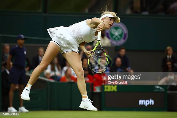 Caroline Wozniacki of Denmark serves during the Ladies Singles first round match against Svetlana Kuznetsova of Russia on day two of the Wimbledon...