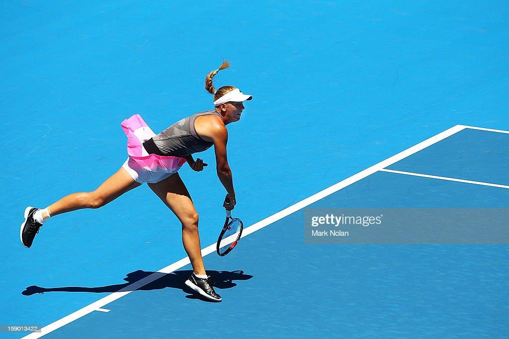 Caroline Wozniacki of Denmark serves in her first round match against Urszula Radwanska of Poland during day one of the Sydney International at Sydney Olympic Park Tennis Centre on January 6, 2013 in Sydney, Australia.