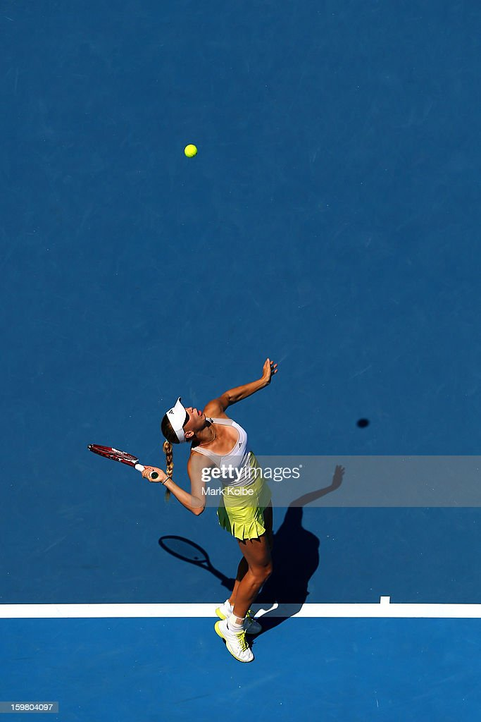 Caroline Wozniacki of Denmark serves in her fourth round match against Svetlana Kuznetsova of Russia during day eight of the 2013 Australian Open at Melbourne Park on January 21, 2013 in Melbourne, Australia.