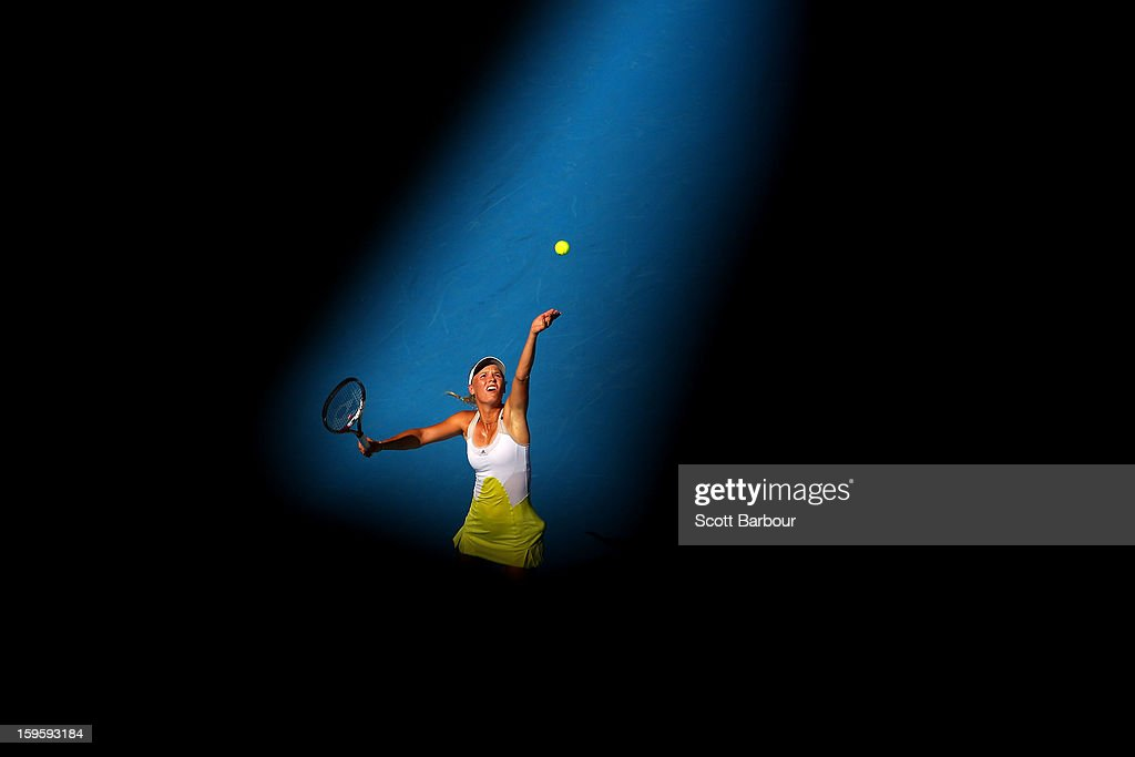 <a gi-track='captionPersonalityLinkClicked' href=/galleries/search?phrase=Caroline+Wozniacki&family=editorial&specificpeople=740679 ng-click='$event.stopPropagation()'>Caroline Wozniacki</a> of Denmark serves in her second round match against Donna Vekic of Croatia during day four of the 2013 Australian Open at Melbourne Park on January 17, 2013 in Melbourne, Australia.