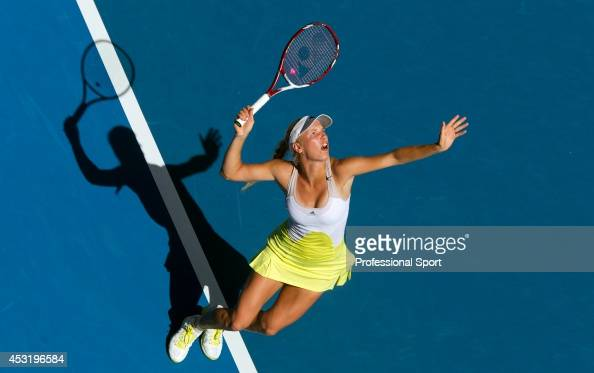 Caroline Wozniacki of Denmark serves in her second round match against Donna Vekic of Croatia during day four of the 2013 Australian Open at...