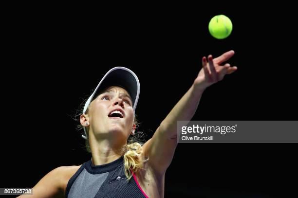 Caroline Wozniacki of Denmark serves in her singles semi final match against Karolina Pliskova of Czech Republic during day 7 of the BNP Paribas WTA...