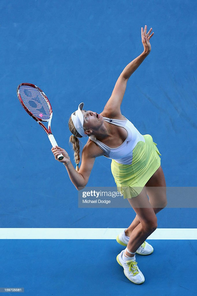 Caroline Wozniacki of Denmark serves in her third round match against Lesia Tsurenko of the Ukraine during day six of the 2013 Australian Open at Melbourne Park on January 19, 2013 in Melbourne, Australia.
