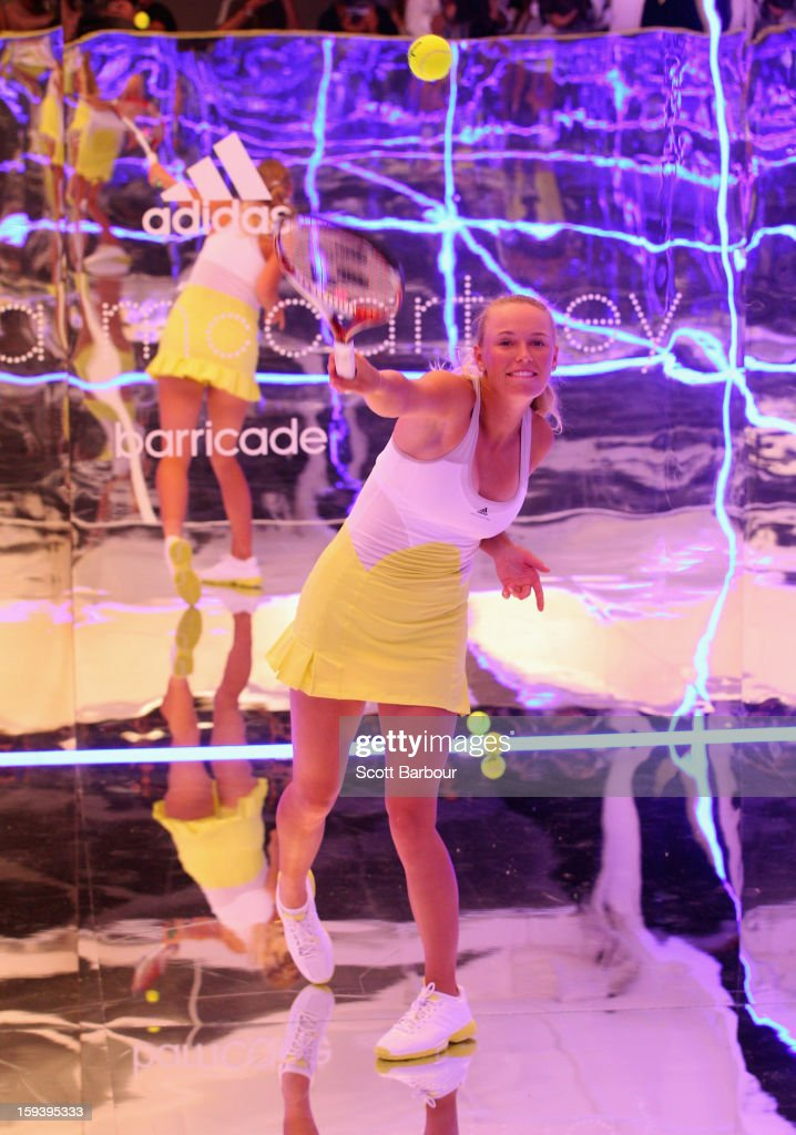 Caroline Wozniacki of Denmark serves on a mirror court at the Adidas by Stella McCartney media launch on January 13, 2013 in Melbourne, Australia. To globally launch the first adidas by Stella McCartney collection tennis players Caroline Wozniacki, Maria Kirilenko and Laura Robson played tennis in the world's first mirror court.
