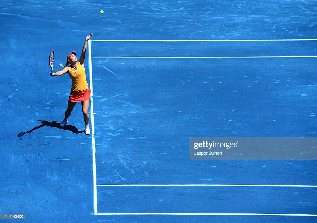 Caroline Wozniacki of Denmark serves the ball to Serena Williams of the USA during the Mutua Madrilena Madrid Open tennis tournament at the Caja Magica on May 10, 2012 in Madrid, Spain.