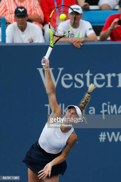 Caroline Wozniacki of Denmark serves to Elena Vesnina of Russia during Day 5 of the Western and Southern Open at the Lindner Family Tennis Center on...