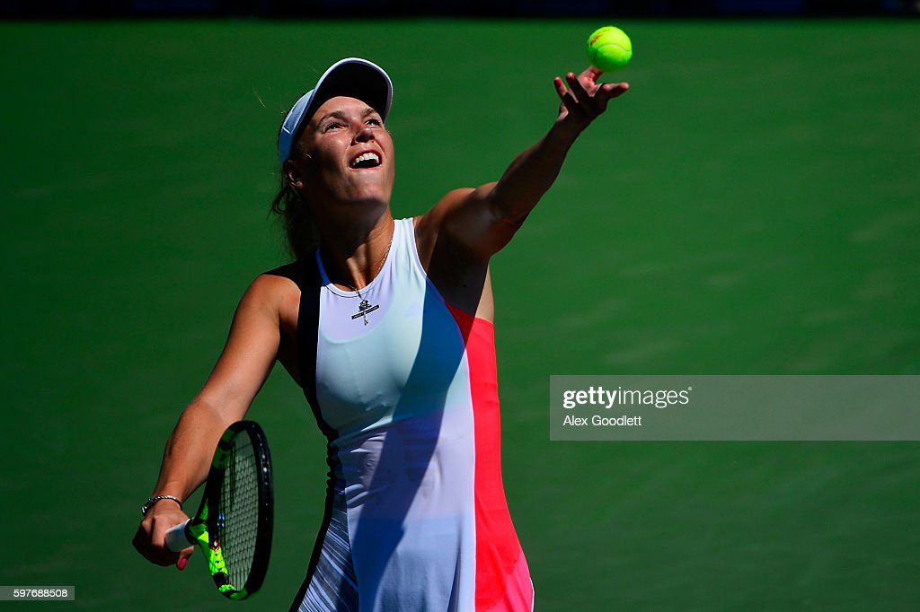 Caroline Wozniacki of Denmark serves to Taylor Townsend of the United States during her first round Women's Singles match on Day One of the 2016 US...