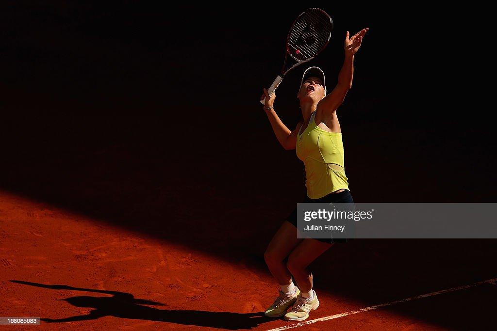 Caroline Wozniacki of Denmark serves to Yaroslava Shvedova of Kazakhstan during day two of the Mutua Madrid Open tennis tournament at the Caja Magica on May 5, 2013 in Madrid, Spain.
