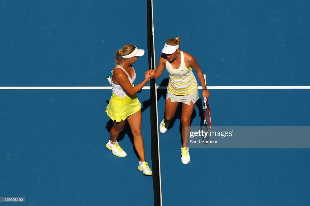<a gi-track='captionPersonalityLinkClicked' href=/galleries/search?phrase=Caroline+Wozniacki&family=editorial&specificpeople=740679 ng-click='$event.stopPropagation()'>Caroline Wozniacki</a> of Denmark shakes hands with Donna Vekic of Croatia after winning their second round match during day four of the 2013 Australian Open at Melbourne Park on January 17, 2013 in Melbourne, Australia.