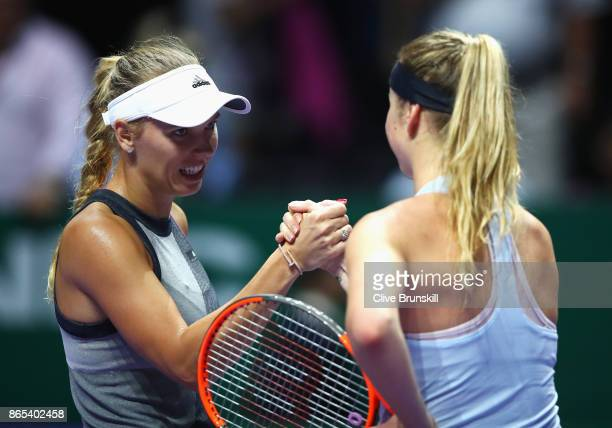 Caroline Wozniacki of Denmark shakes hands with Elina Svitolina of Ukraine after her victory in their singles match during day 2 of the BNP Paribas...
