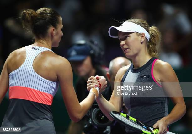 Caroline Wozniacki of Denmark shakes hands with Karolina Pliskova of Czech Republic after her victory in their singles semi final match during day 7...