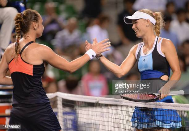 Caroline Wozniacki of Denmark shakes hands with Magdalena Rybarikova of Slovakia after their women's singles third round match during day four of the...