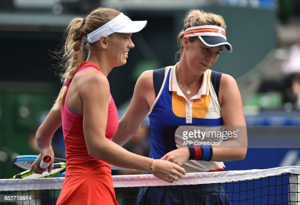 Caroline Wozniacki of Denmark smiles next to Anastasia Pavlyuchenkova of Russia after her victory during the women's singles final at the Pan Pacific...