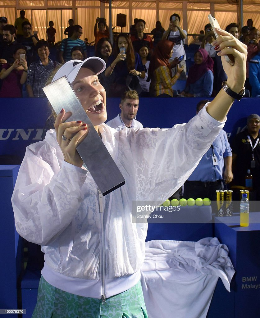 Caroline Wozniacki of Denmark takes a selfie after the Singles Final of the BMW Malaysian Open at the Royal Selnagor Golf Club Centre Court on March...