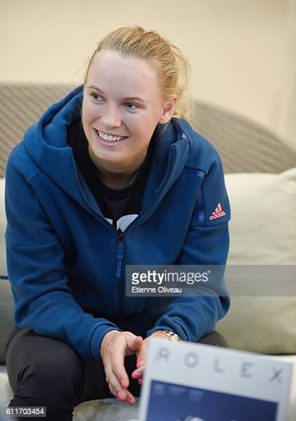 Caroline Wozniacki of Denmark takes an interview at the Rolex Skybox on day 1 of the 2016 China Open at the National Tennis Centre on October 1 2016...