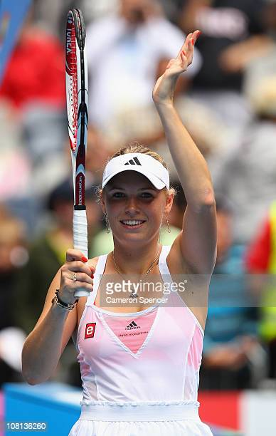 Caroline Wozniacki of Denmark thanks the crowd after winning her second round match against Vania King of the United States of America during day...
