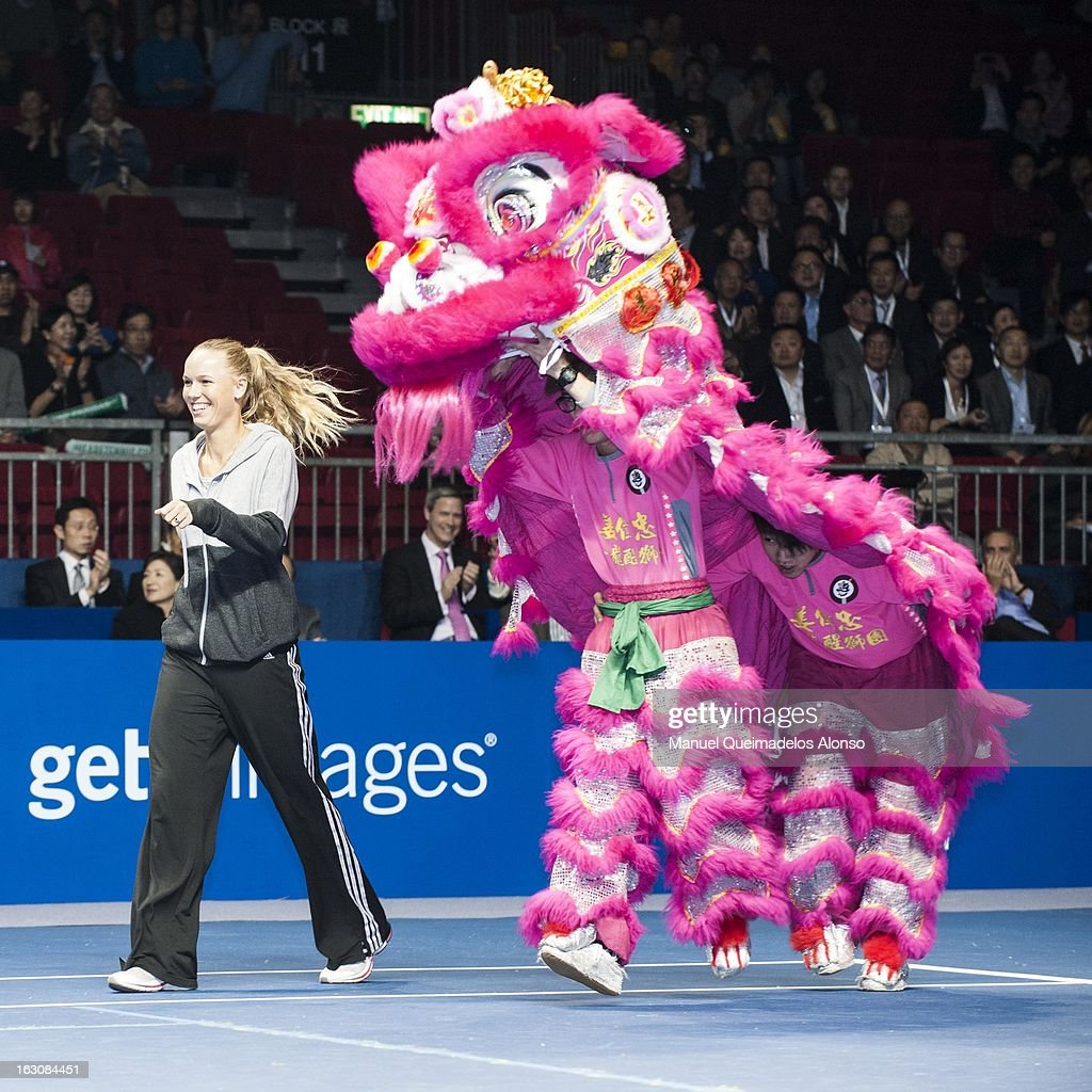 <a gi-track='captionPersonalityLinkClicked' href=/galleries/search?phrase=Caroline+Wozniacki&family=editorial&specificpeople=740679 ng-click='$event.stopPropagation()'>Caroline Wozniacki</a> of Denmark walks next to a Chinese Dancing Lion priot his match against Agnieszka Radwanska as part of the Hong Kong Showdown at the Asia-World Expo on March 4, 2013 in Hong Kong, China.
