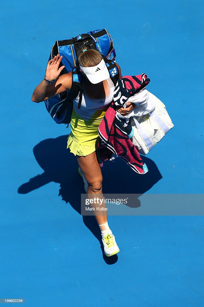 Caroline Wozniacki of Denmark walks off the court after losing her fourth round match against Svetlana Kuznetsova of Russia during day eight of the 2013 Australian Open at Melbourne Park on January 21, 2013 in Melbourne, Australia.