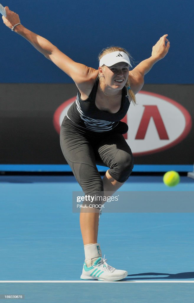 Caroline Wozniacki of Denmark watches her return during a practice session for the upcoming Australian Open tennis tournament in Melbourne on January 10, 2013. The first Grand Slam tennis tournament of the year is set to run from January 14 to 27. AFP PHOTO / Paul CROCK IMAGE