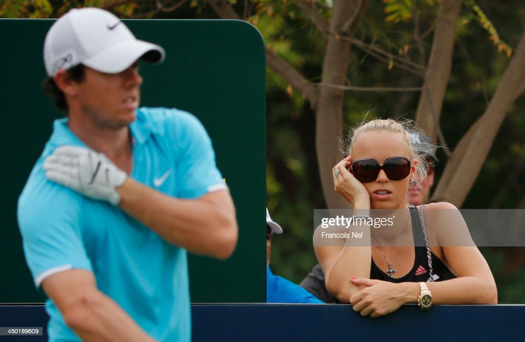 <a gi-track='captionPersonalityLinkClicked' href=/galleries/search?phrase=Caroline+Wozniacki&family=editorial&specificpeople=740679 ng-click='$event.stopPropagation()'>Caroline Wozniacki</a> of Denmark watches <a gi-track='captionPersonalityLinkClicked' href=/galleries/search?phrase=Rory+McIlroy&family=editorial&specificpeople=783109 ng-click='$event.stopPropagation()'>Rory McIlroy</a> of Northern Ireland during the during the final round of the 2013 DP World Championships on the Earth Course at the Jumeirah Golf Estates on November 17, 2013 in Dubai, United Arab Emirates.