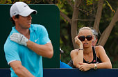 Caroline Wozniacki of Denmark watches Rory McIlroy of Northern Ireland during the during the final round of the 2013 DP World Championships on the...