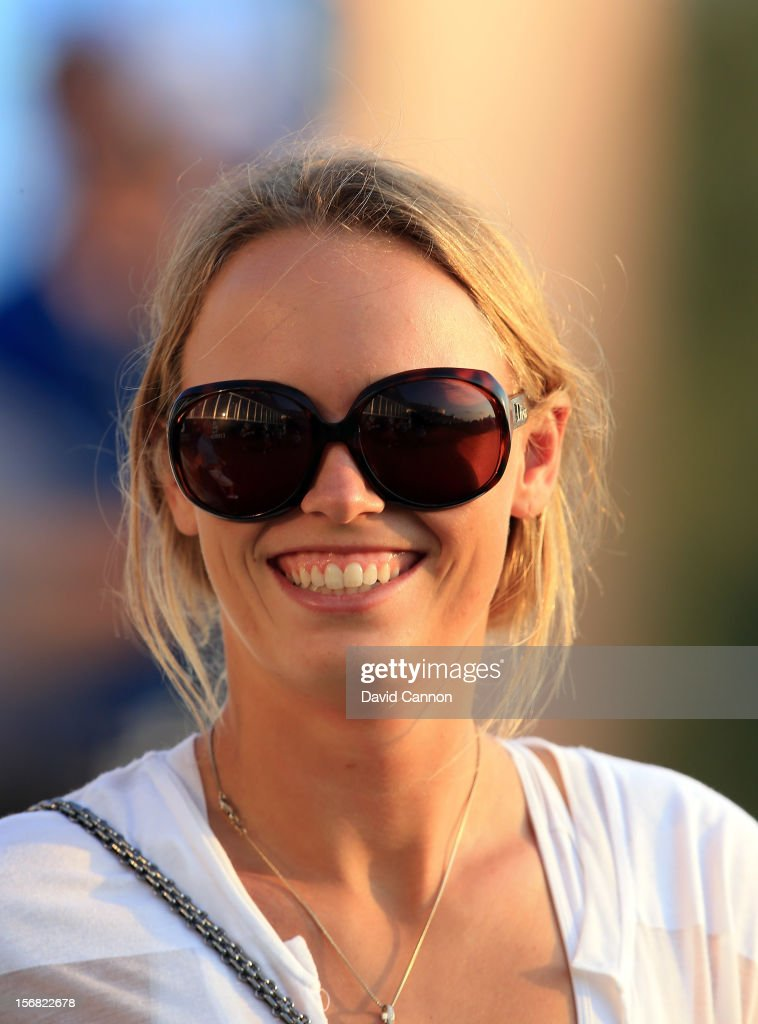 Caroline Wozniacki of Denmark watching her boyfriend Rory McIlroy of Northern Ireland during the first round of the 2012 DP World Tour Championship on the Earth Course at Jumeirah Golf Estates on November 22, 2012 in Dubai, United Arab Emirates.