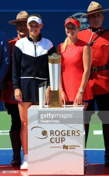 Caroline Wozniacki of Denmark with the runner up trophy and Elina Svitolina of Ukraine with the winners trophy following the final match on Day 9 of...