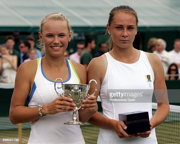 Caroline Wozniacki of Denmark with the trophy in the girl's junior final after defeating Magdalena Rybarikova of Slovakia during day twelve of the...