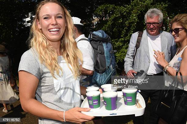 Caroline Wozniacki serves Lavazza coffee to the queue at Wimbledon on July 1 2015 in London England