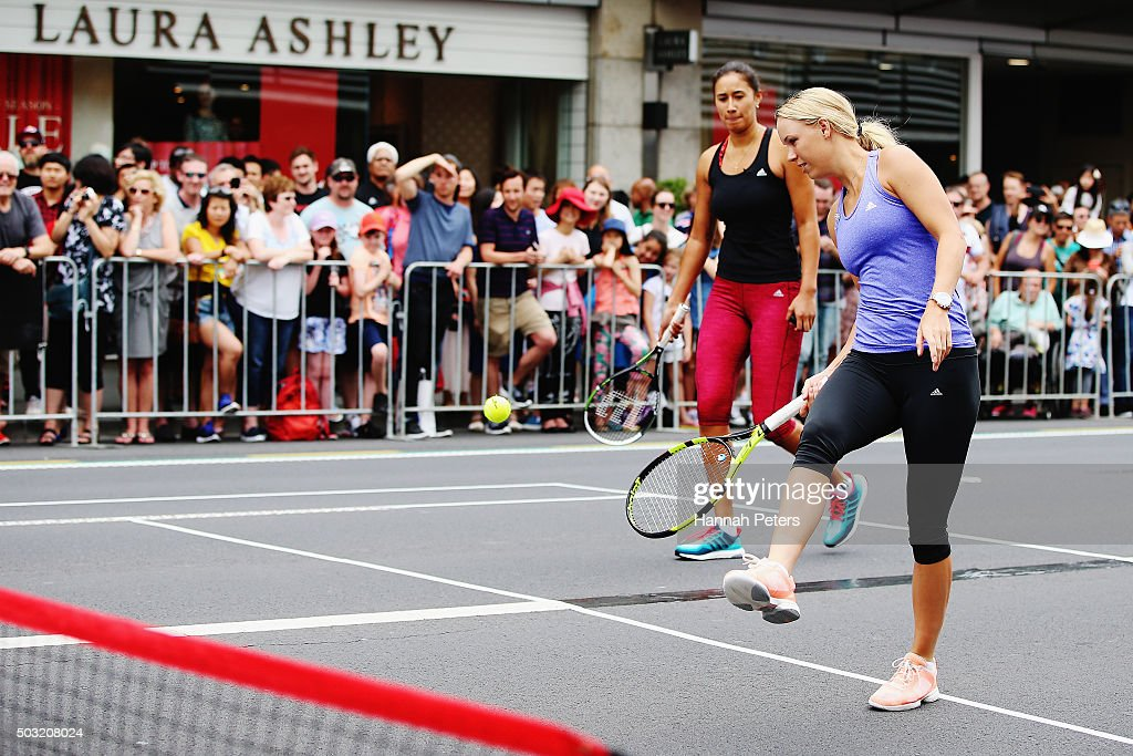 Caroline Wozniacki takes part in an exhibition tennis match with New Zealand netball player Maria Tutaia on January 3, 2016 in Auckland, New Zealand. The ASB Classic starts on Monday 4, 2016.