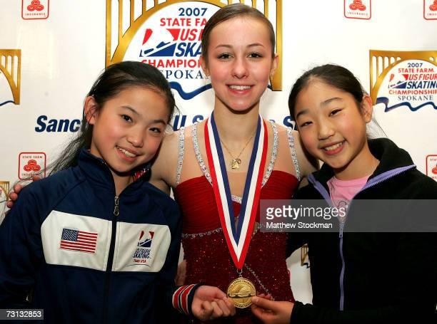 Caroline Zhang junior ladies silver medalist Kimmie Meissner senior ladies champion and Mirai Nagasu junior ladies champion pose for a photograph...