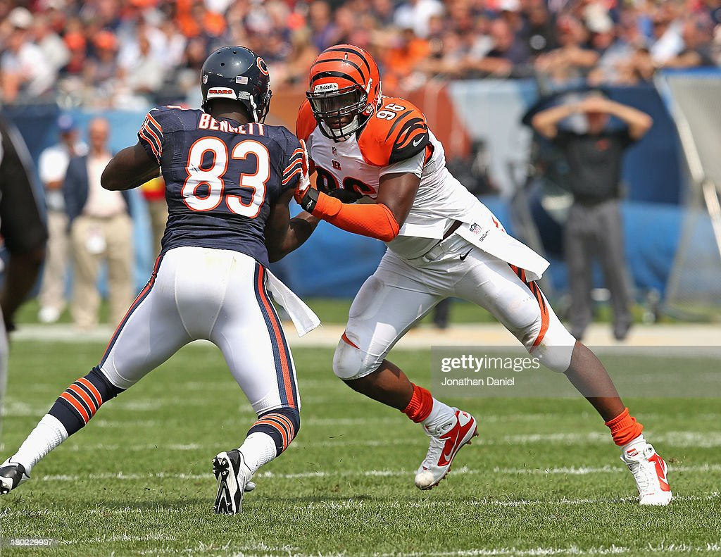 Carolos Dunlap #96 of the Cincinnati Bengals rushes against Martellus Bennett #83 of the Chicago Bears at Soldier Field on September 8, 2013 in Chicago, Illinois. The Bears defeated the Bengals 24-21.