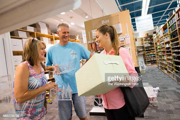 Carolyn and Brian Cain of Clovis California shop for school items with their daughter Sami Cain an incoming freshman at American University at the...